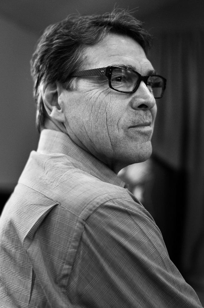 "<a href=""/images/rick-perry-2"">Own this image</a>"